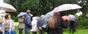 Braving the rain for the dedication of the new plaque in the churchyard of St Mary, Hadlow, Kent, on 19 October 2013.